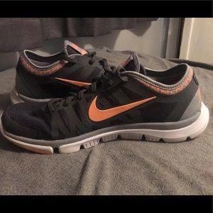 Light gray and light orange Aztec Nike's